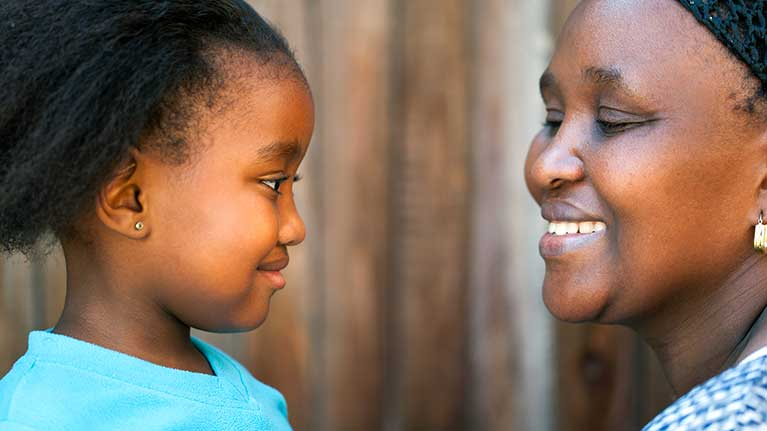Side view of african mother and daughter.